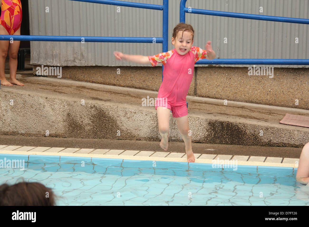 Child jumps into water during Hydrotherapy (hydropathy) treatment - Stock Image