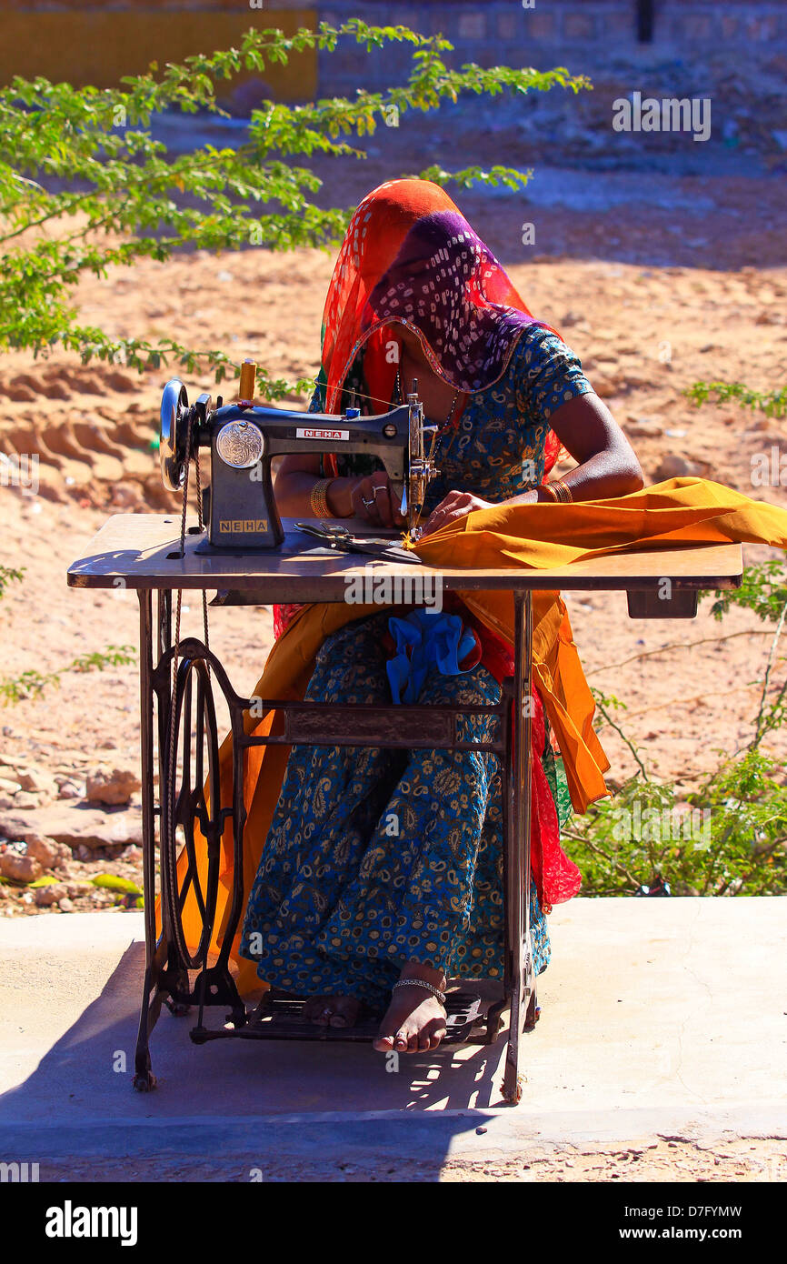 Woman sewing - Stock Image