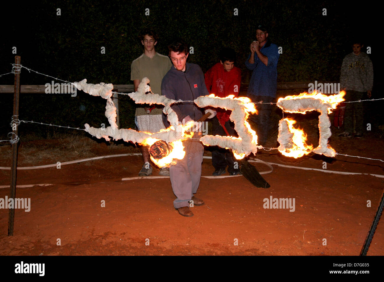 fire inscription lit during swearing in ceremony of youth movement - Stock Image
