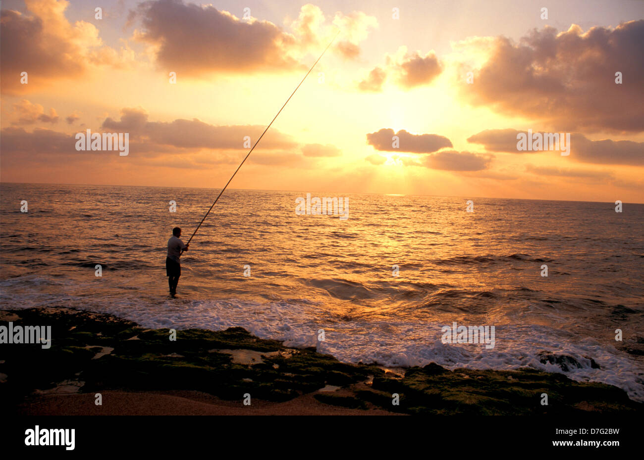 fisherman on nahariya beach - Stock Image