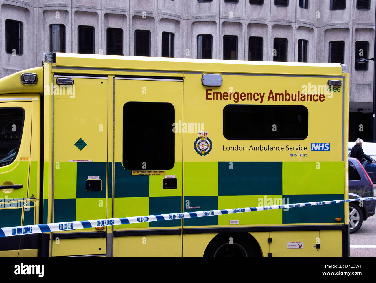 London Emergency Ambulance with Police Line tape saying do not cross, Euston Road, London England UK - Stock Image