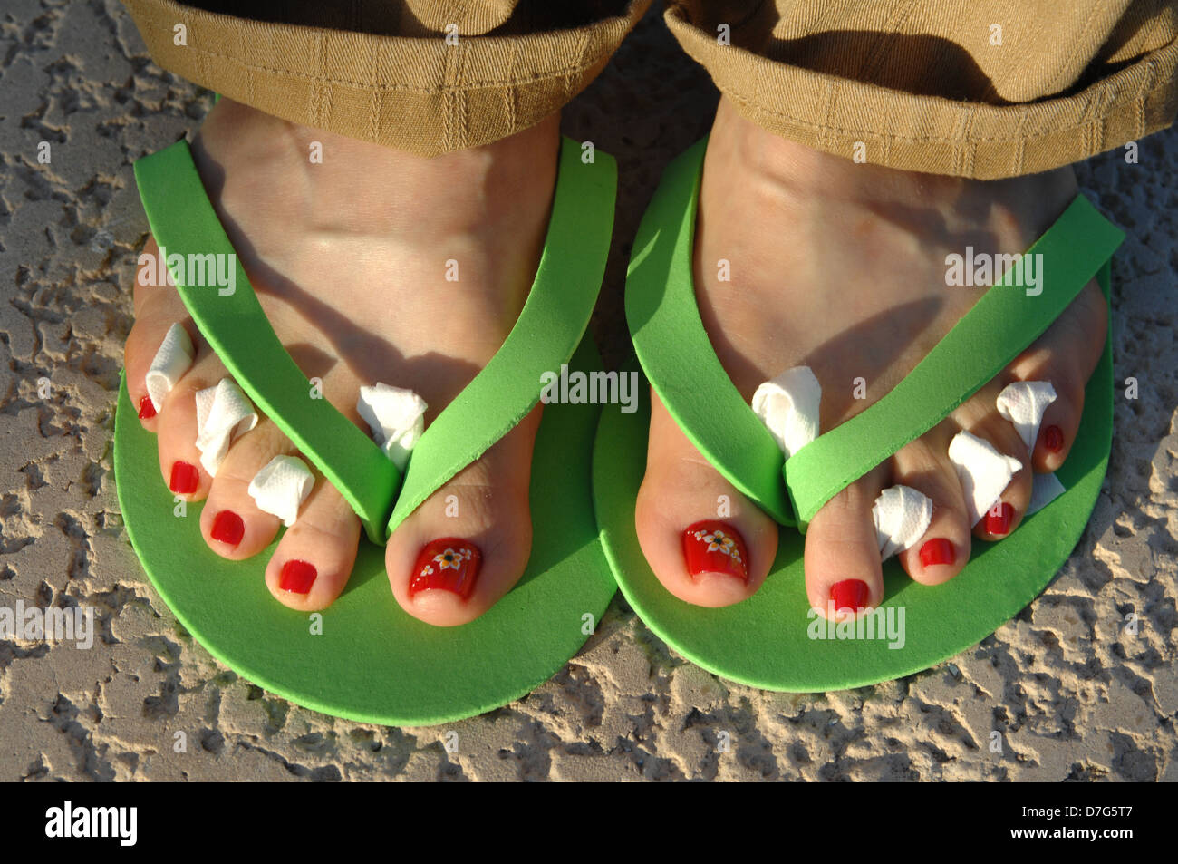 916393a7f45b Stock Image of Feet After a Pedicure With Fresh Polish and Tissue Between  the Toes Wearing