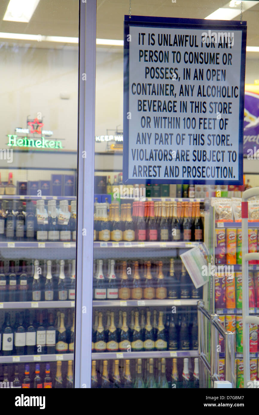 Miami Beach Florida Walgreens Liquor store wine beer alcoholic beverages drinks sign window unlawful to consume - Stock Image