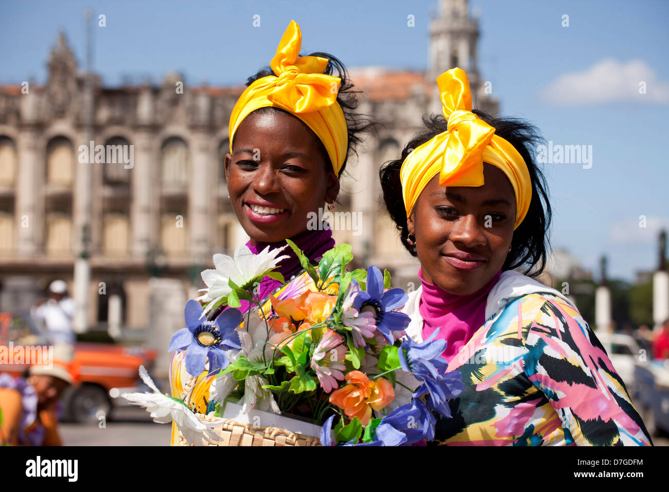 young woman with headscarf and colourful flowers, Havana, Cuba, Caribbean - Stock Image