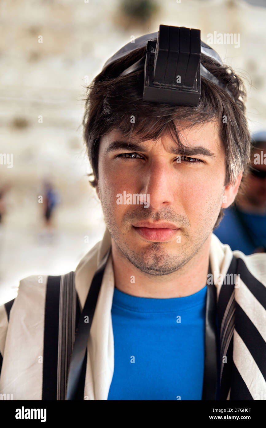 Portrait an adult Caucasian Jewish man on blurred background Western Wall in Jerusalem holiest site to Jewish people. - Stock Image