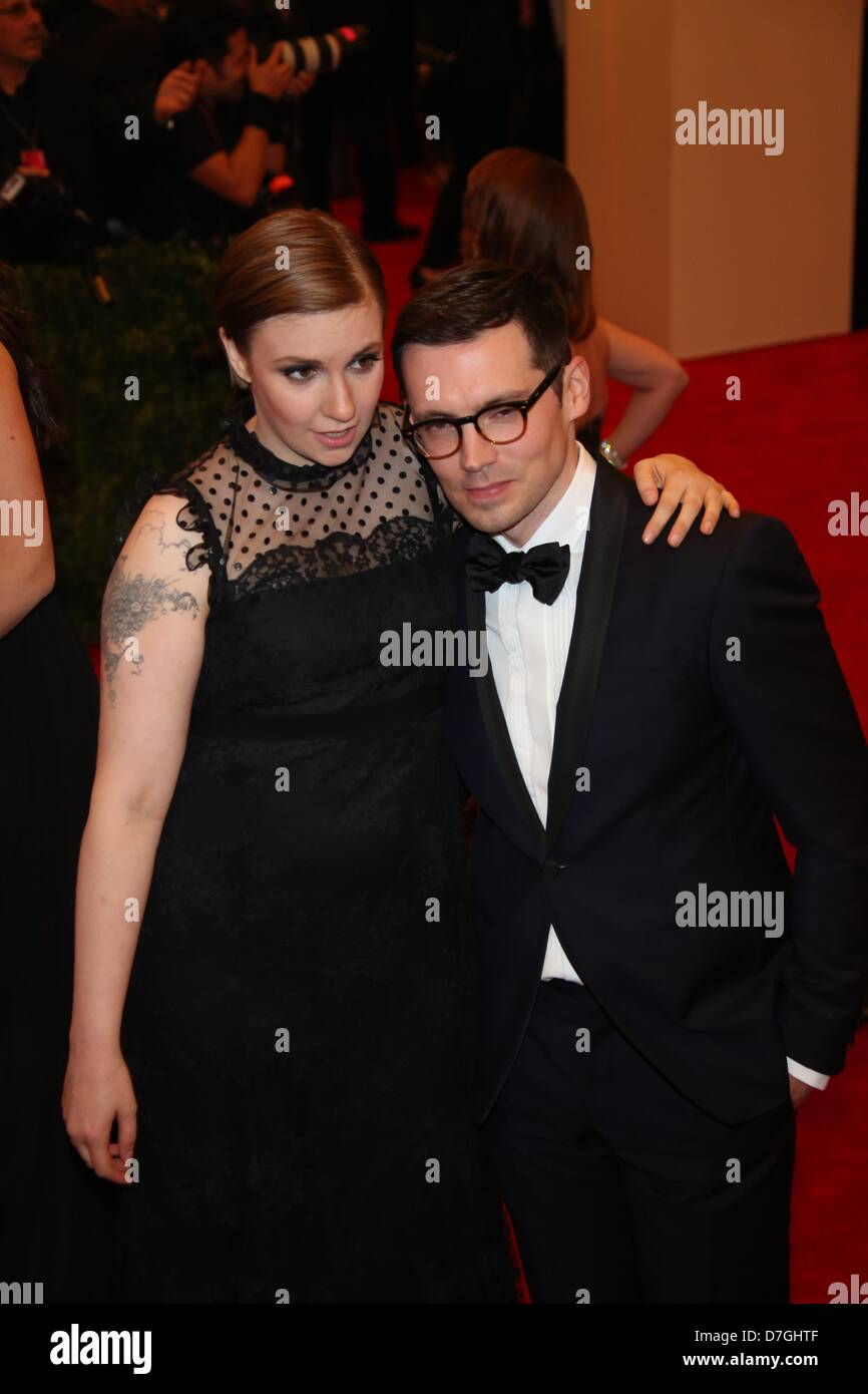 Lena Dunham and Erdem Moralioglu arrive at the Costume Institute Gala for the 'Punk: Chaos to Couture' exhibition - Stock Image