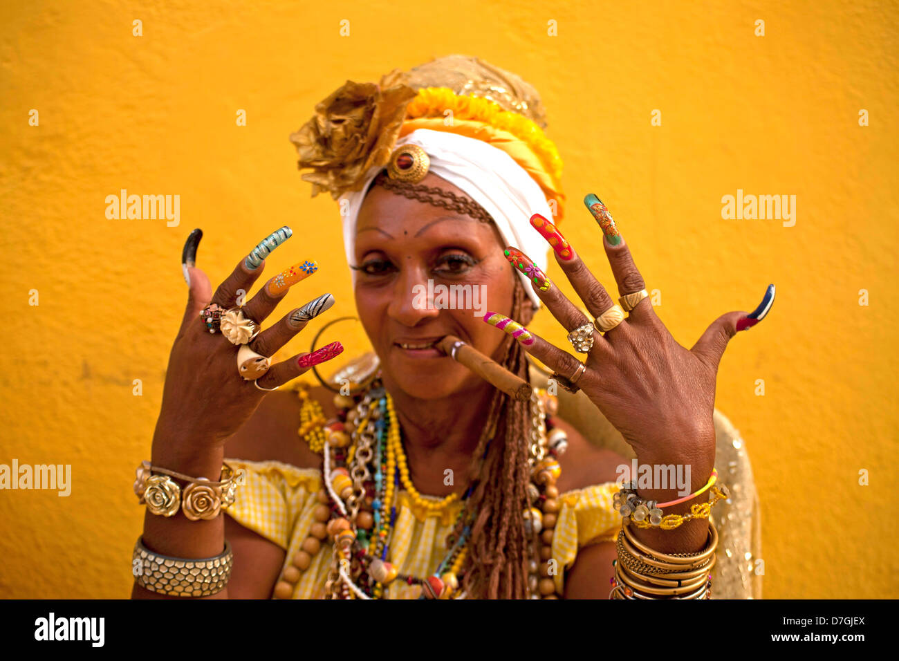 Senora Habana, A priestess of the afro-cuban Santeria with colourful long nails and cigar, Havana, Cuba, Caribbean - Stock Image