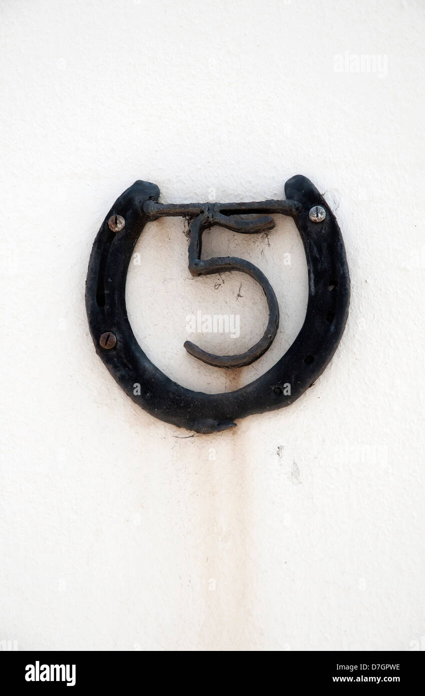 number 5 in horseshoe - Stock Image