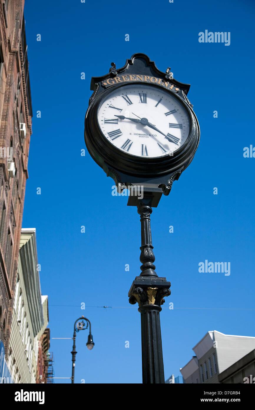 Ornate Iron Clock Stands on Manhattan Avenue, Greenpoint Brooklyn, USA - Stock Image