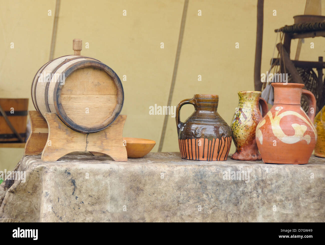 Old clay vessels and wooden cask used for storing wine and ale , on display at a country fete - Stock Image