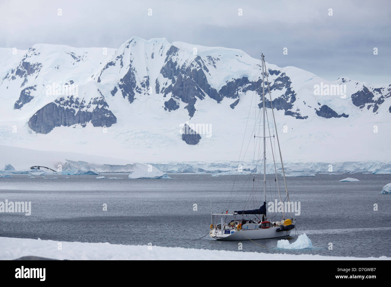 A sailboat at Cuverville Island, Antarctica. - Stock Image