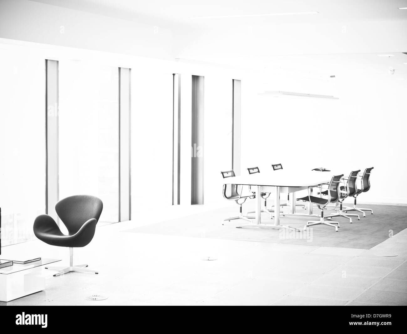 Stylised black and white architectural image of modern office environment. - Stock Image
