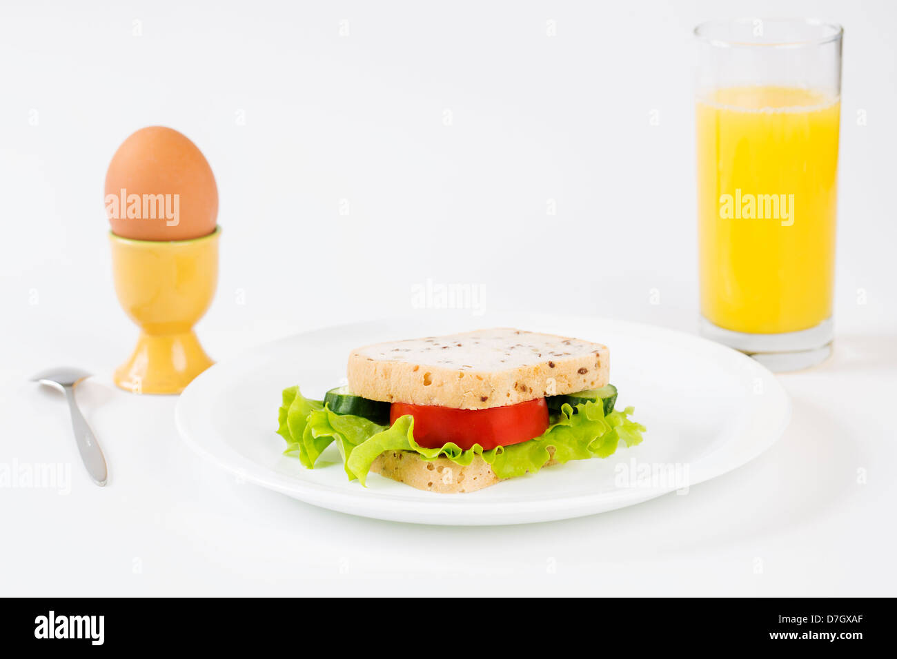Sandwich between egg and juice satisfy hungry stomach - Stock Image