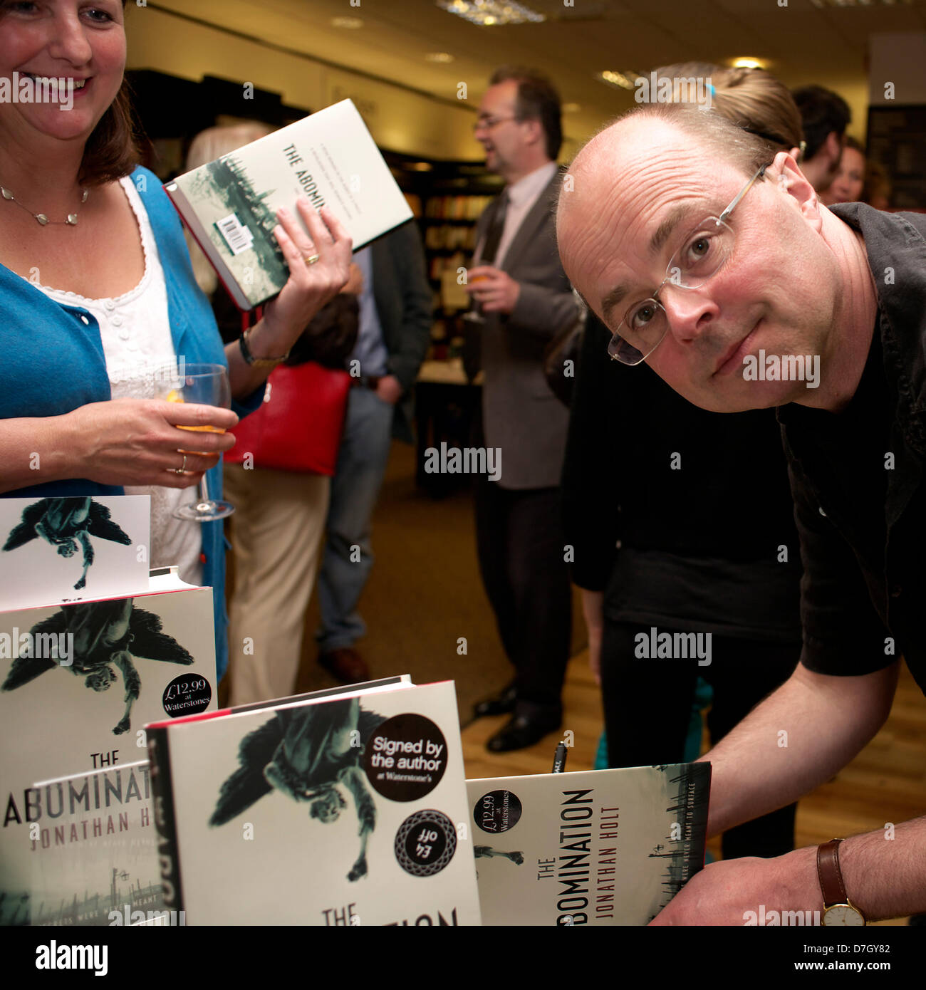 Oxford, UK. 7th May, 2013. Author Jonathan Holt signs copies of his new book The Abomination at Waterstones Bookshop, - Stock Image
