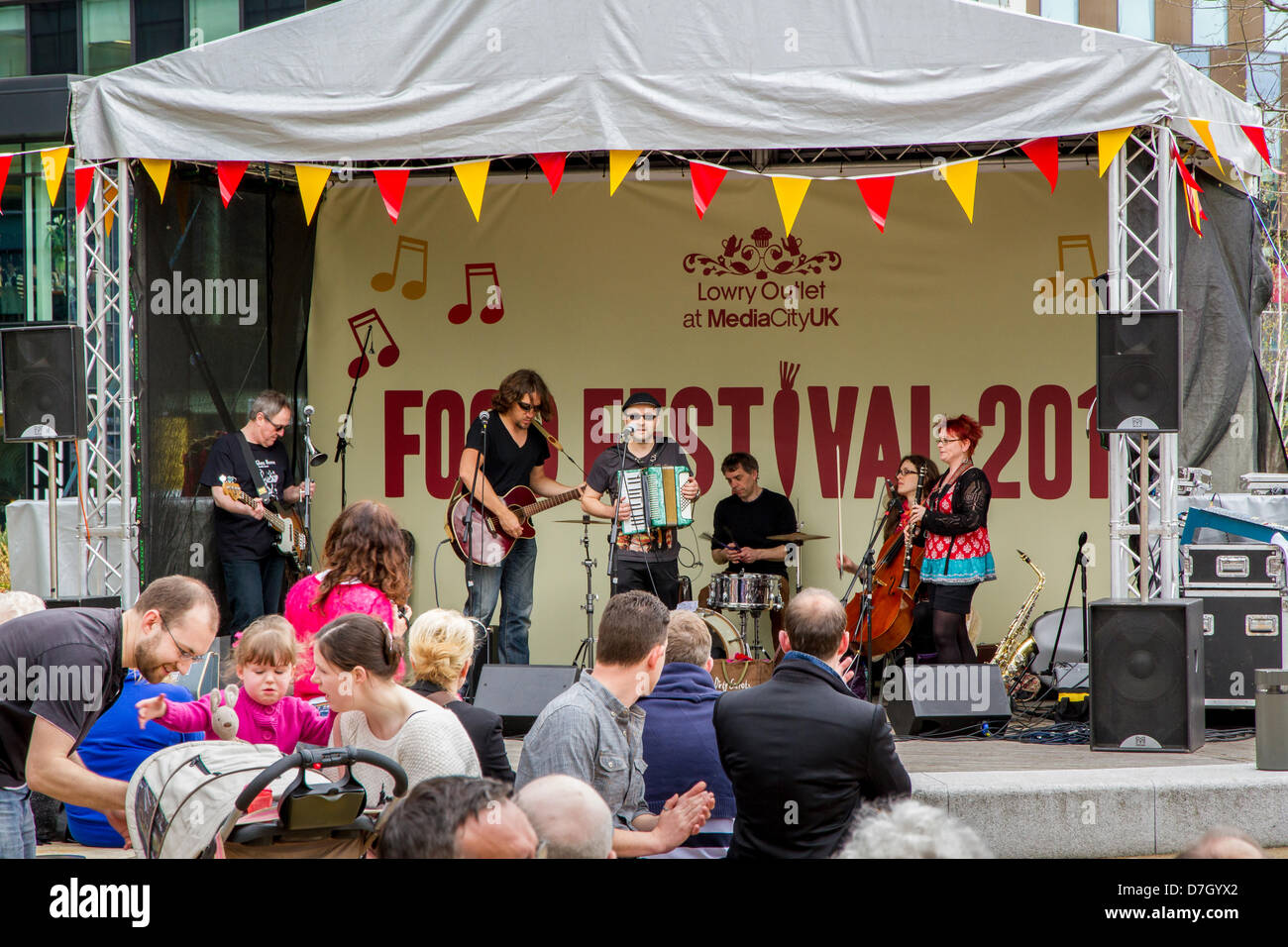 Salford, UK. 5th May 2013. Folk band Lazlo Baby perform at the first ever Lowry Outlet Food Festival 2013 at MediaCity - Stock Image
