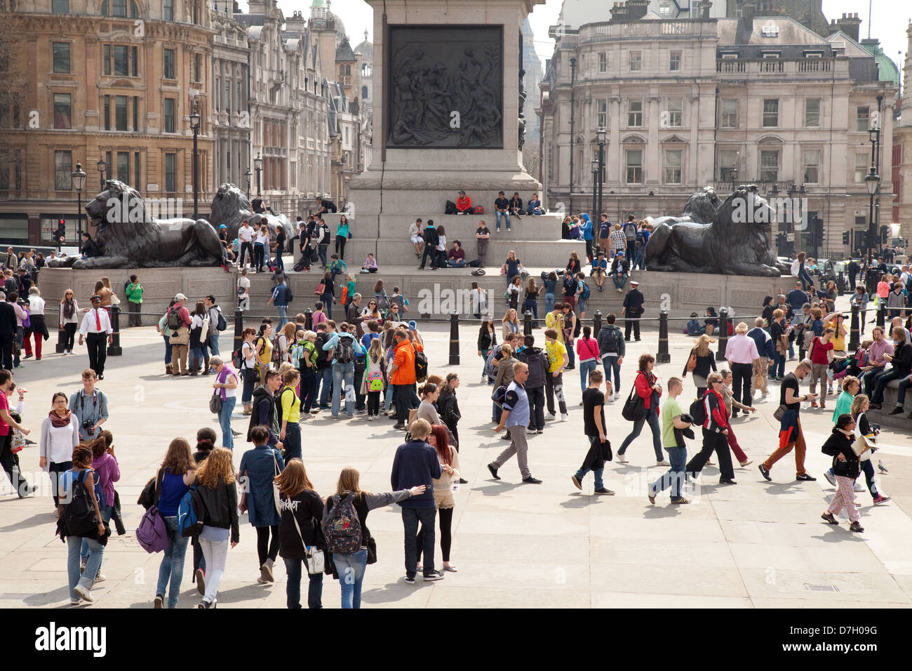 Crowds of people in Trafalgar Square in spring, London WC2, central London, UK - Stock Image