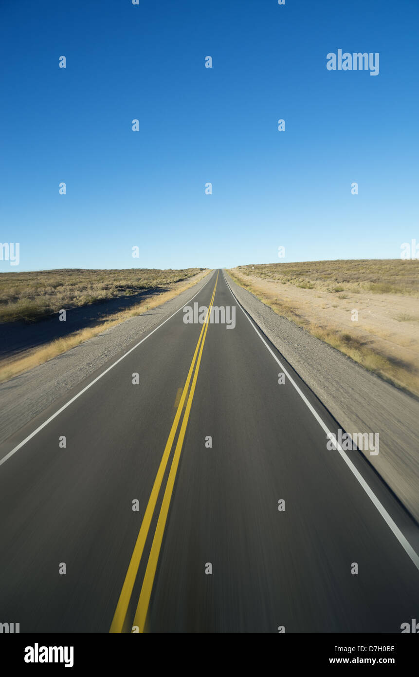 straight open road to the horizon with motion blur - Stock Image