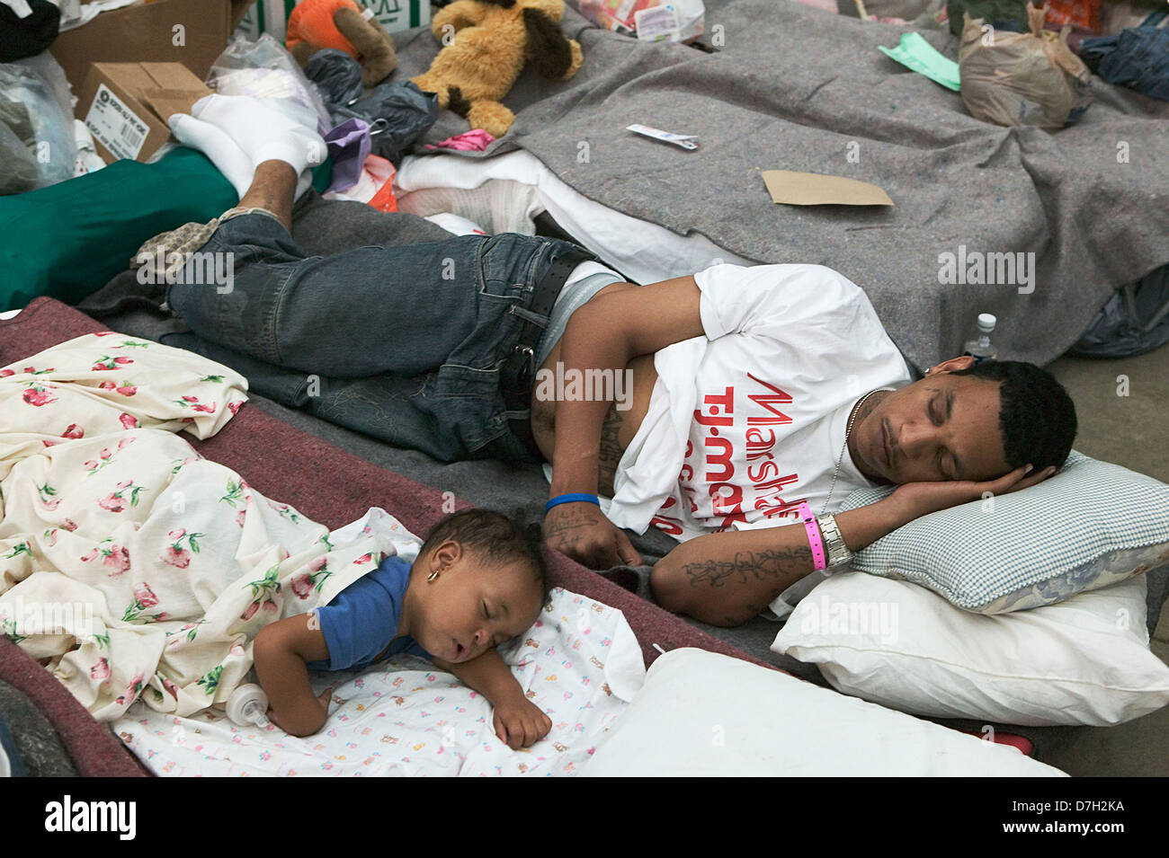 Hurricane Katrina survivors from New Orleans rest after being evacuated to a Red Cross shelter in the Houston Astrodome - Stock Image