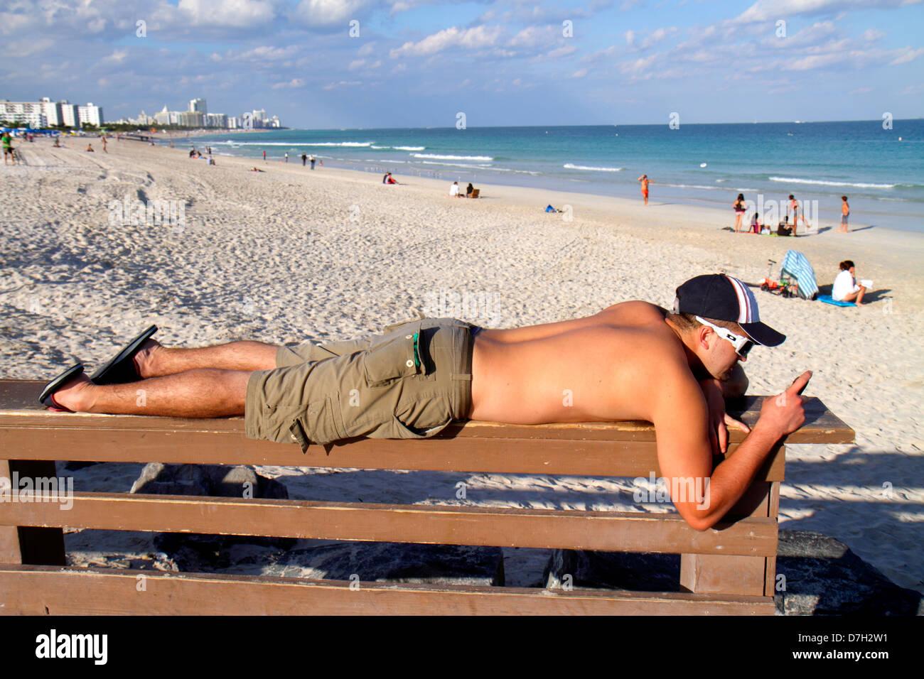 Man Sunbathing In Park Stock Photos  Man Sunbathing In -4507