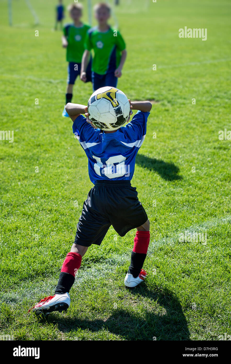 Throwin during youth soccer match. - Stock Image
