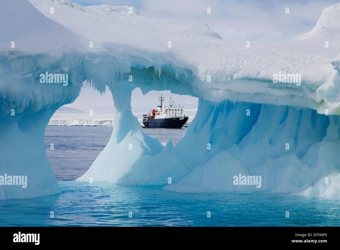 Icebreaker Ortelius through an Iceberg at Brown Bluff, Antarctica. - Stock Image