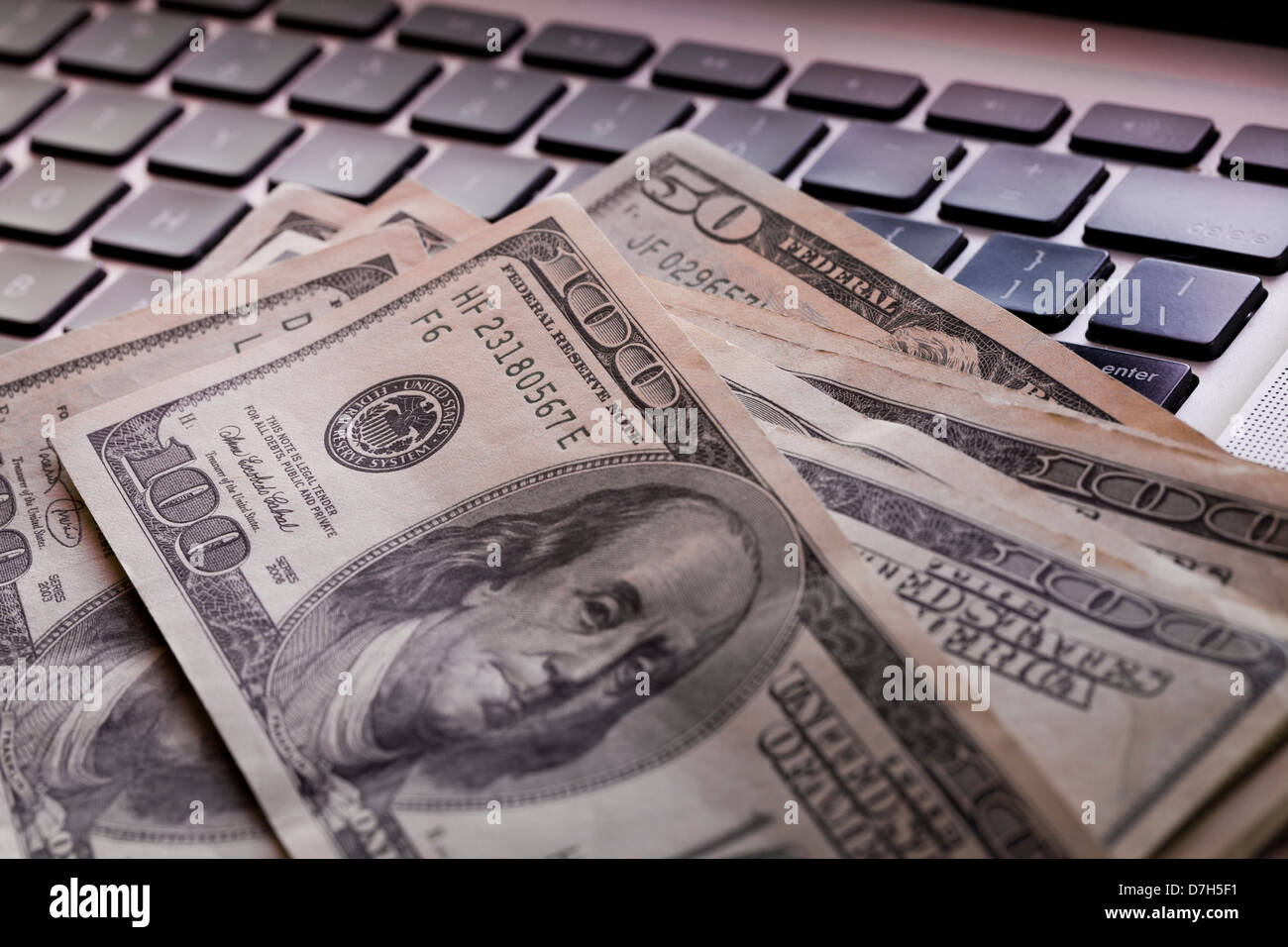 Money on computer keyboard - Stock Image