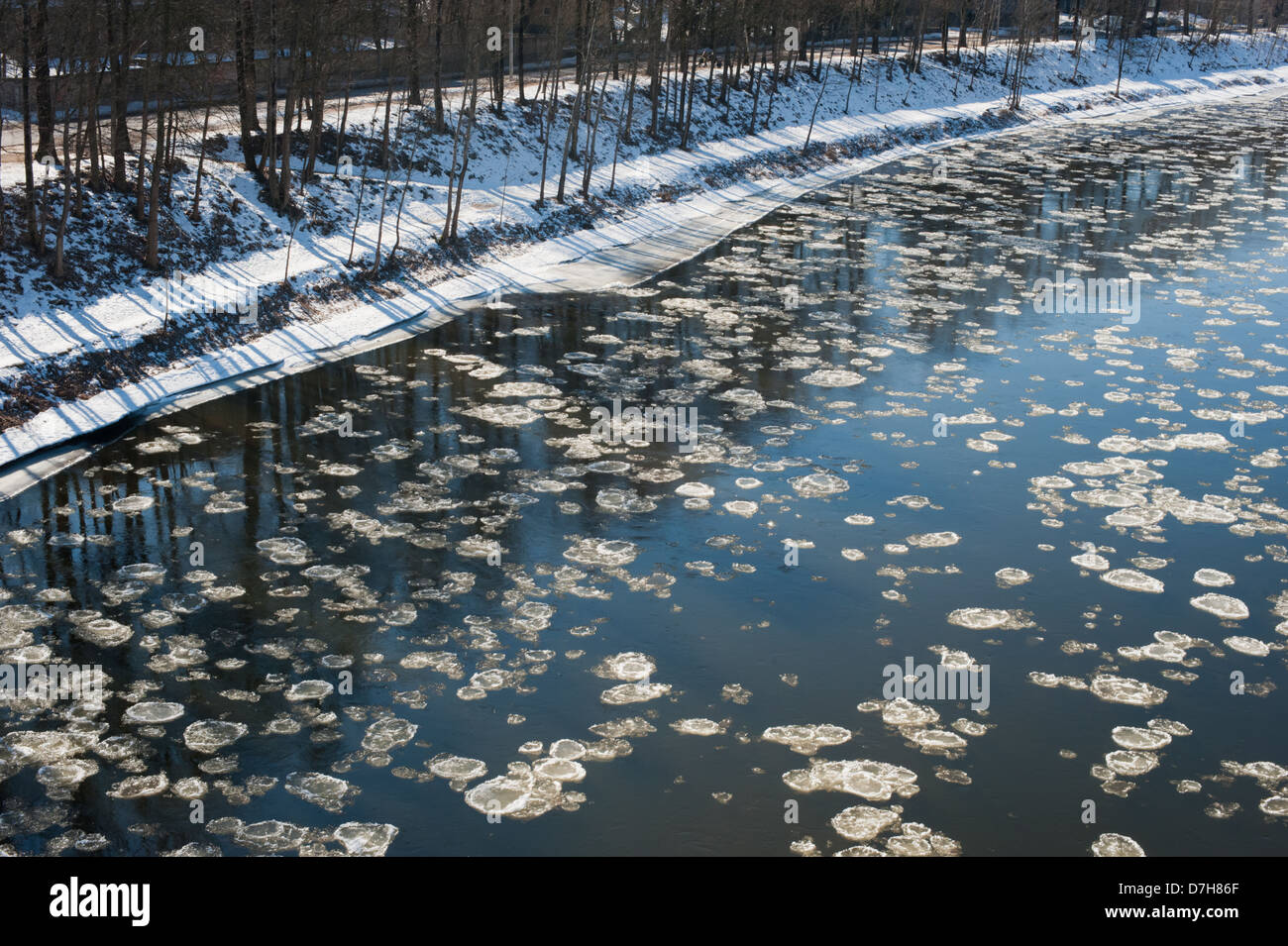 As Spring brings warmth to Lithuania, Ice bergs flow down the River Neris in Vilnius. - Stock Image