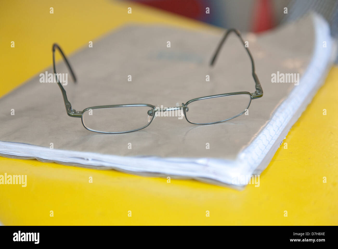 close up on a pair of glasses on top of a school book Stock Photo