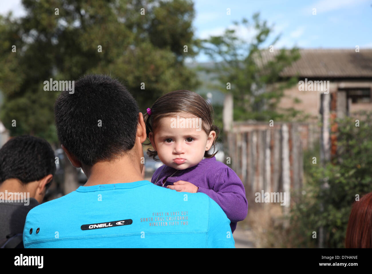 Chimbarongo Child looks over his shoulder father - Stock Image