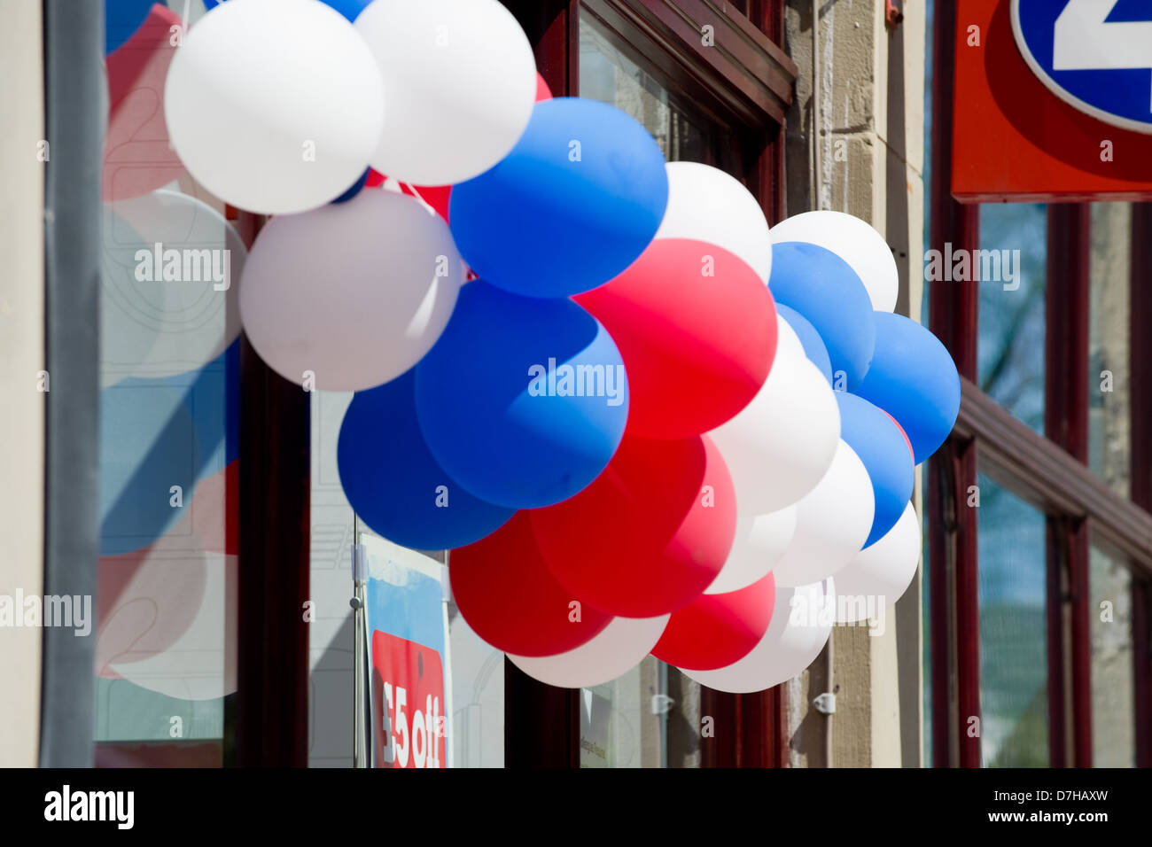 Balloons outside a high street store for an in-store promotion. - Stock Image