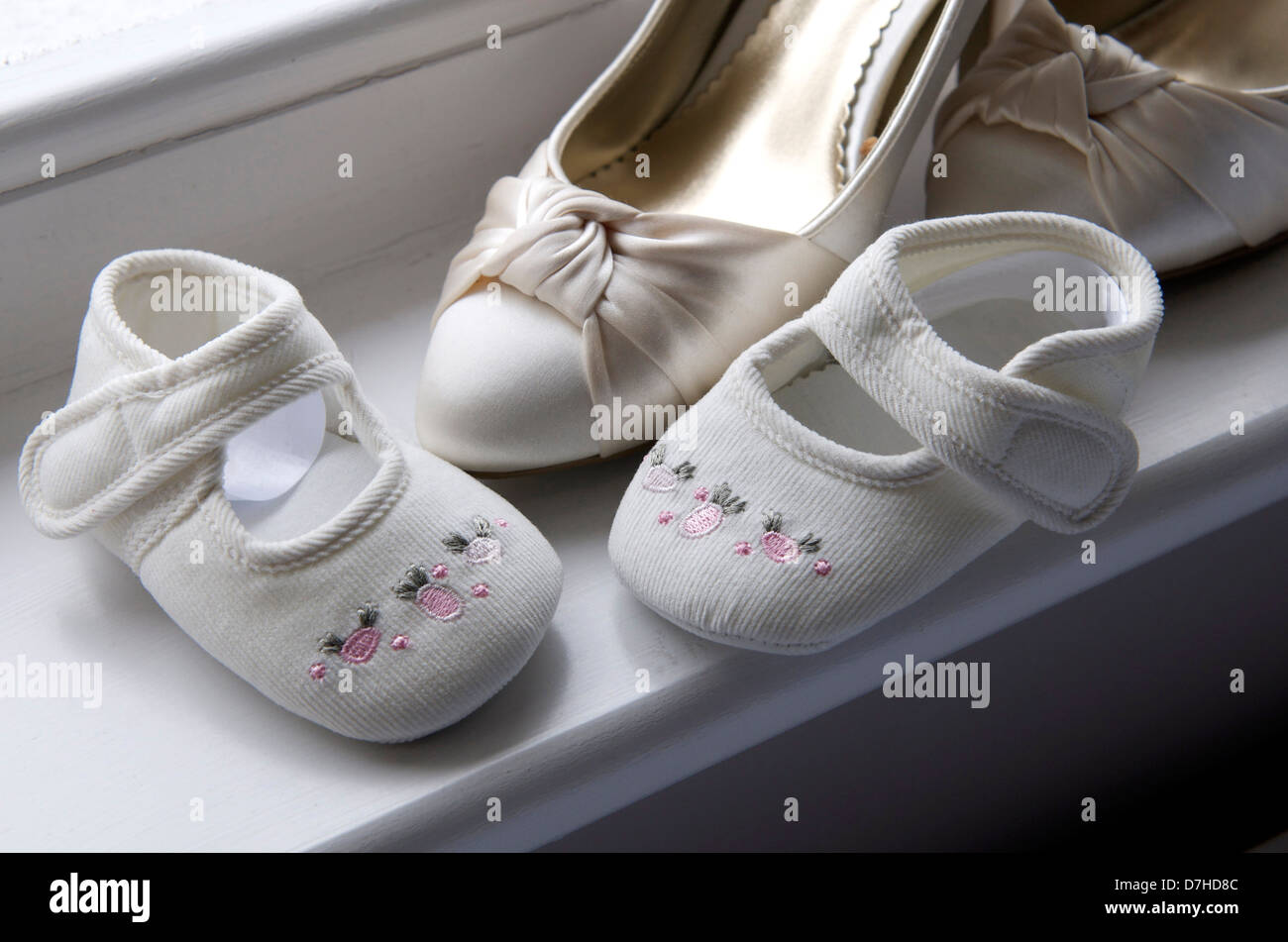 brides and Childs wedding shoes on window seal Stock Photo