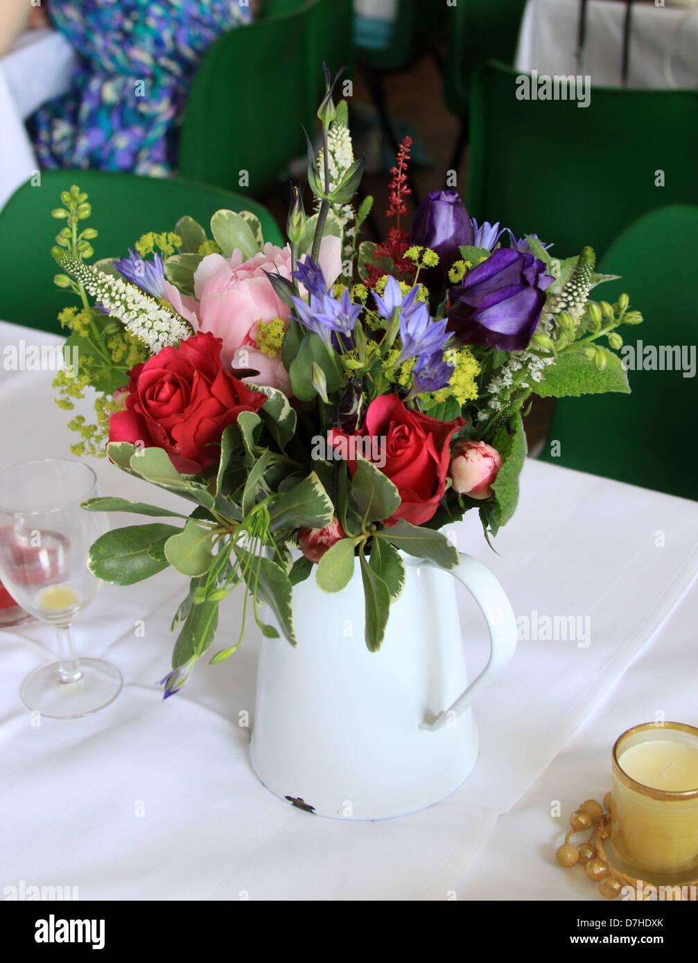 Bouquet of wedding flowers in a white enamel jug - vintage / shabby ...