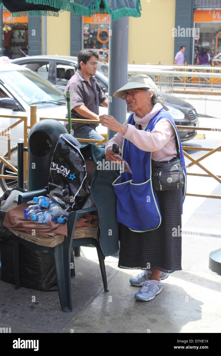 Peru Lima old woman street trader street vendor - Stock Image