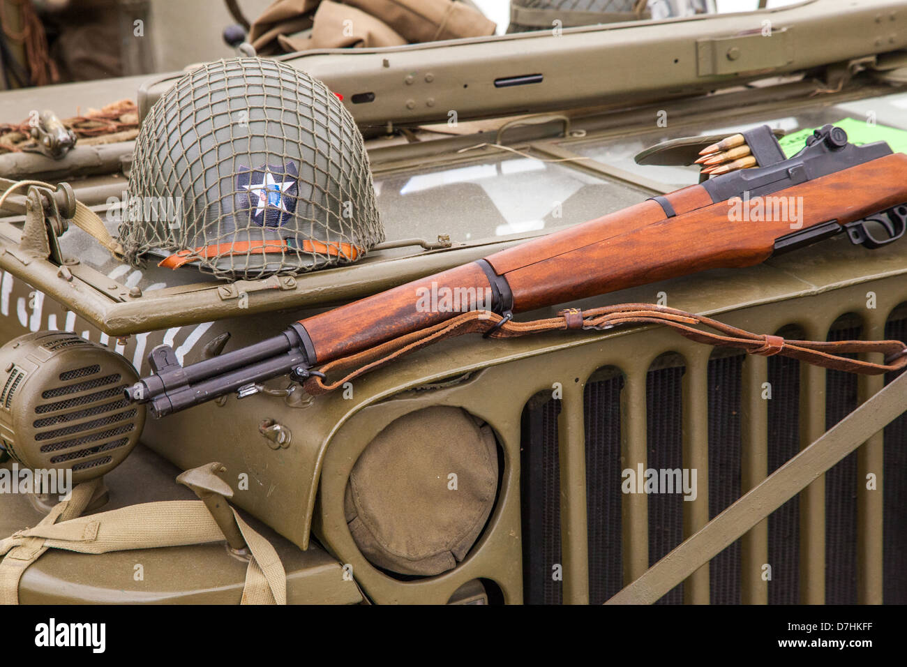American WW2 Jeep with helmet and rifle (re-enactment, deactivated) - Stock Image
