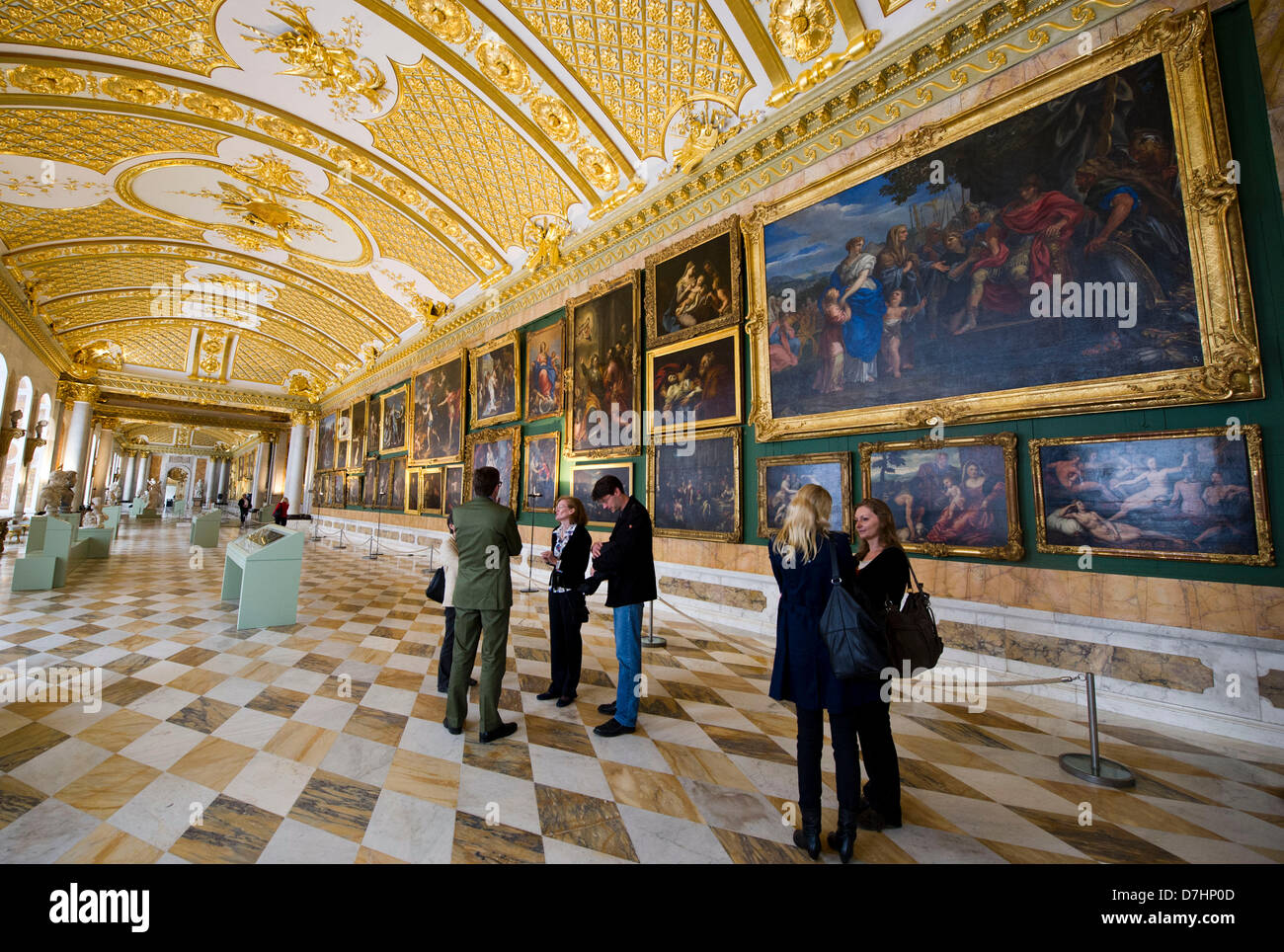 Journalists look at different pictures of the exhibition 'The most beautiful gallery' in the picture gallery - Stock Image
