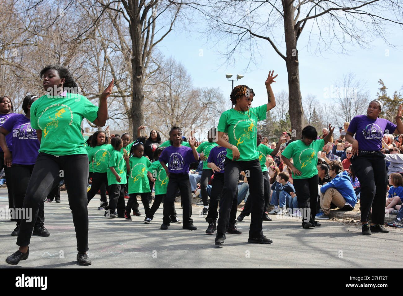A troupe of young African American dancers dancing at the May Day parade in Minneapolis, Minnesota. - Stock Image