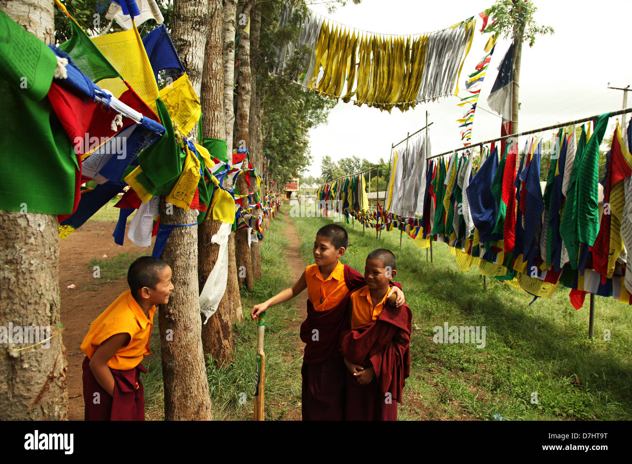 Child monks having a fun time in Bylakuppe, India. - Stock Image