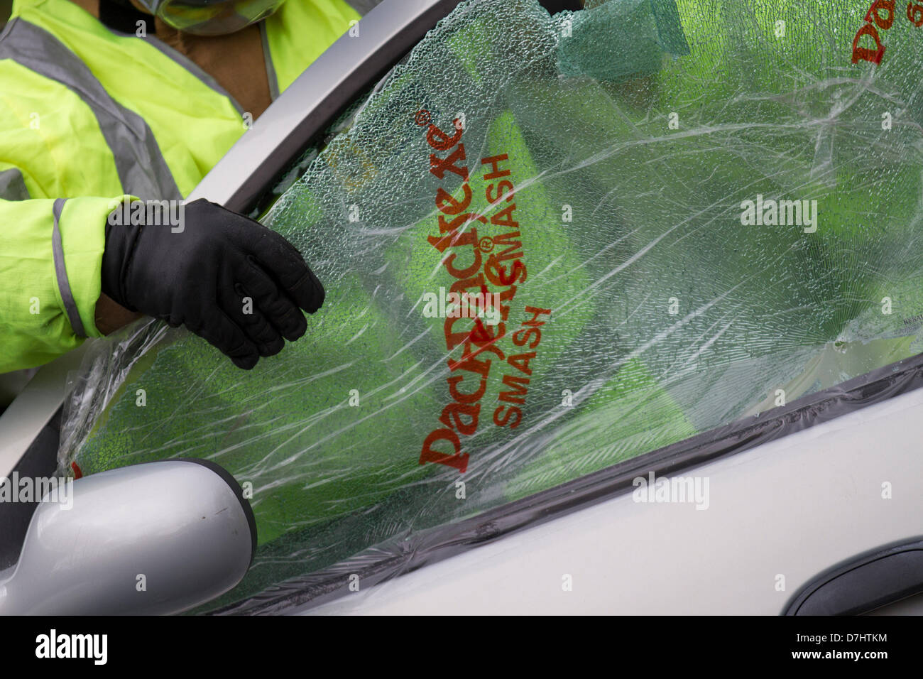 Formby, Merseyside, UK  8th May, 2013. Packexe Smash Film on broken window, used in a Rescue Demonstration during - Stock Image