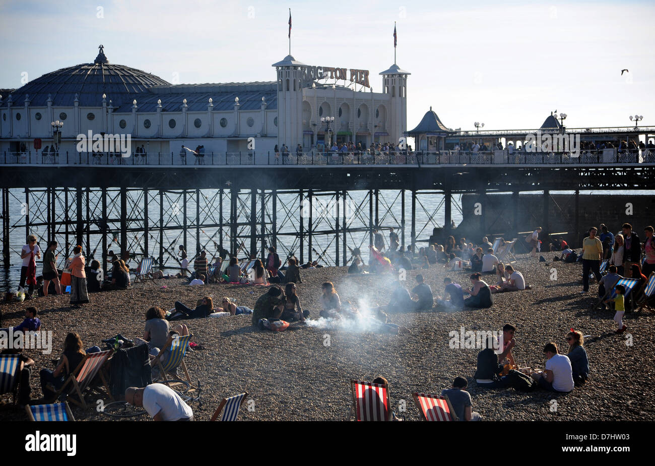 Brighton UK  - Barbecue smoke starts to waft across Brighton beach in the early evening - Stock Image