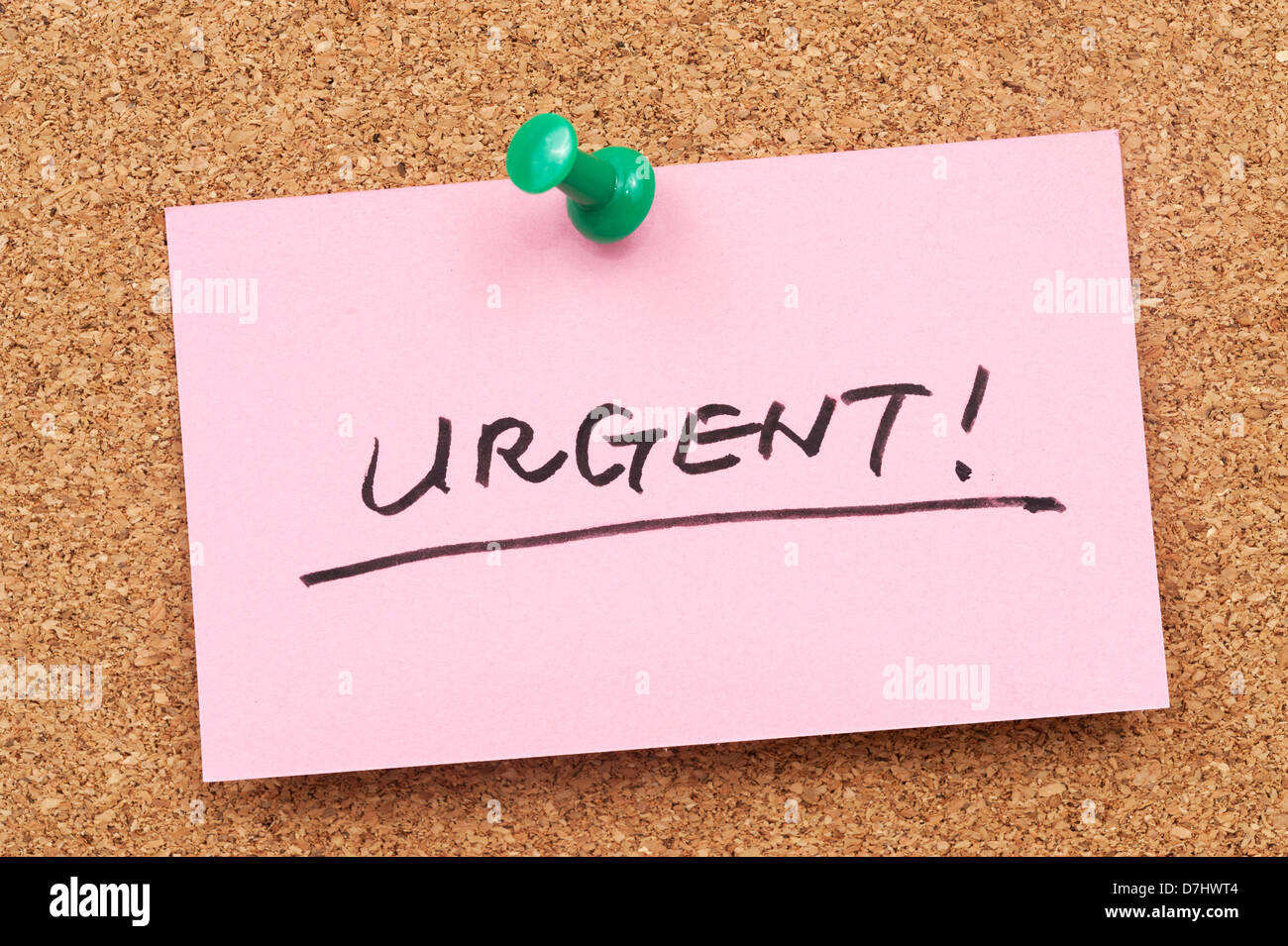 Urgent word written on paper and pinned on cork board - Stock Image