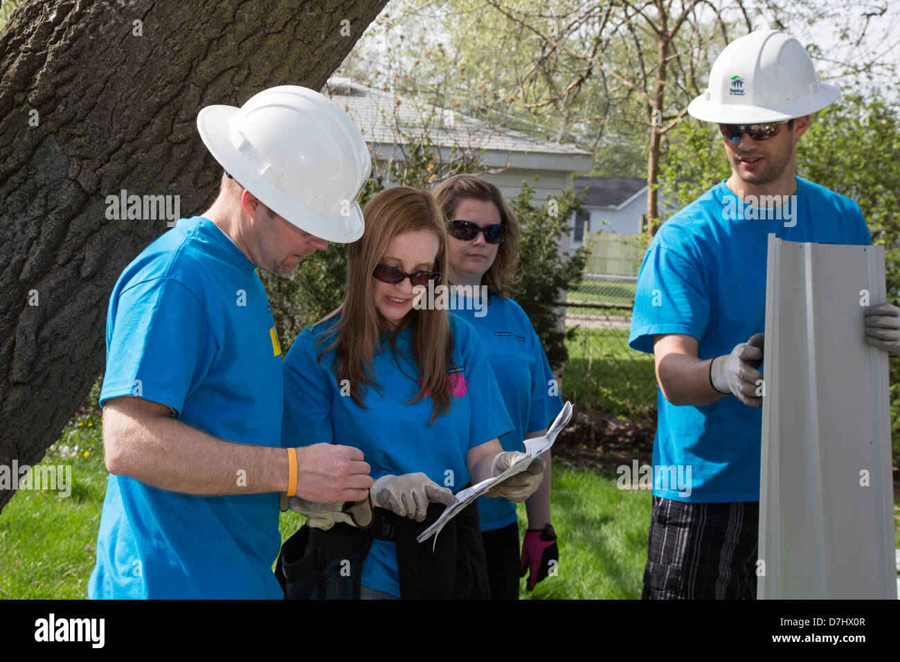 Volunteers Rehabilitate a House for Habitat for Humanity - Stock Image