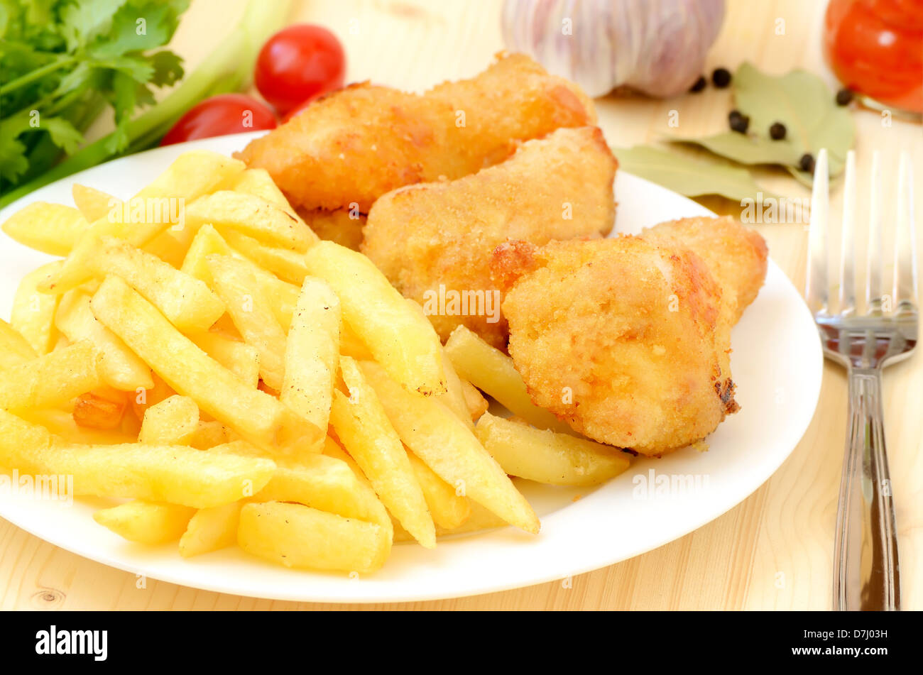 Fried chicken with french fries on the table - Stock Image