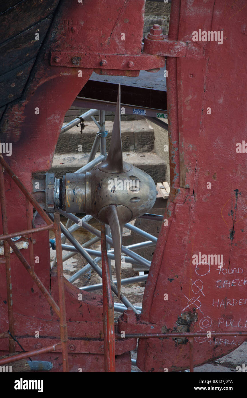 ship propellor, dry dock, repairs, maintainance,wooden hull, rudder,steel propellor - Stock Image