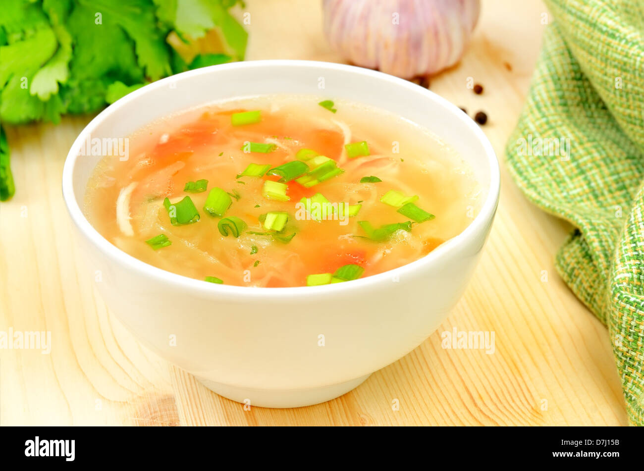 Sauerkraut soup in white bowl on wooden table - Stock Image