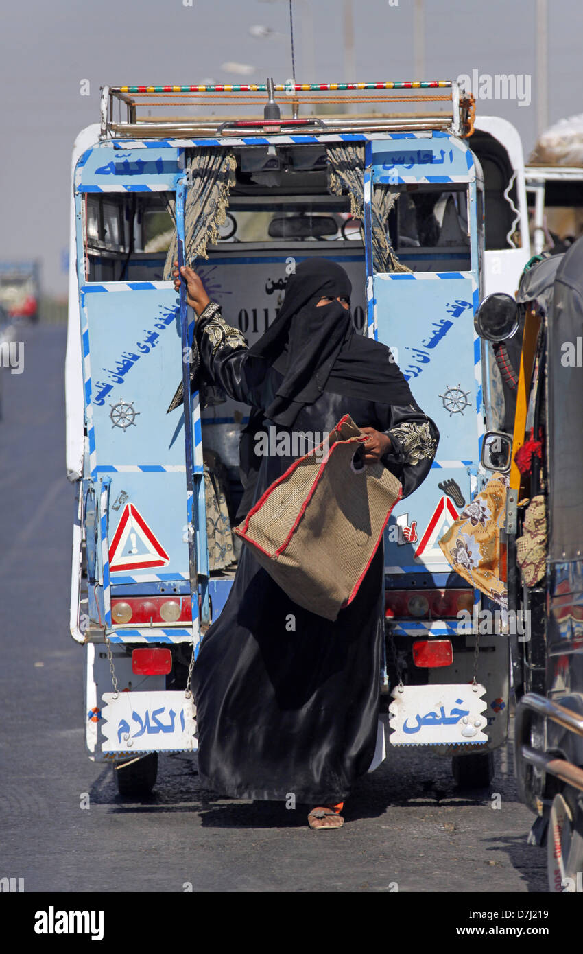 EGYPTIAN WOMAN IN BURKA NEAR ASWAN EGYPT 11 January 2013 - Stock Image