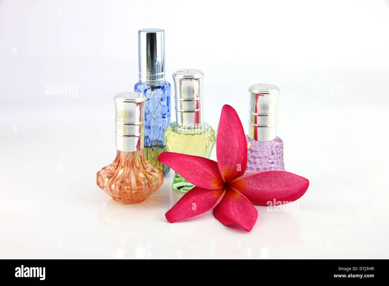 the red flowers and orange blue green violet perfume bottles on the