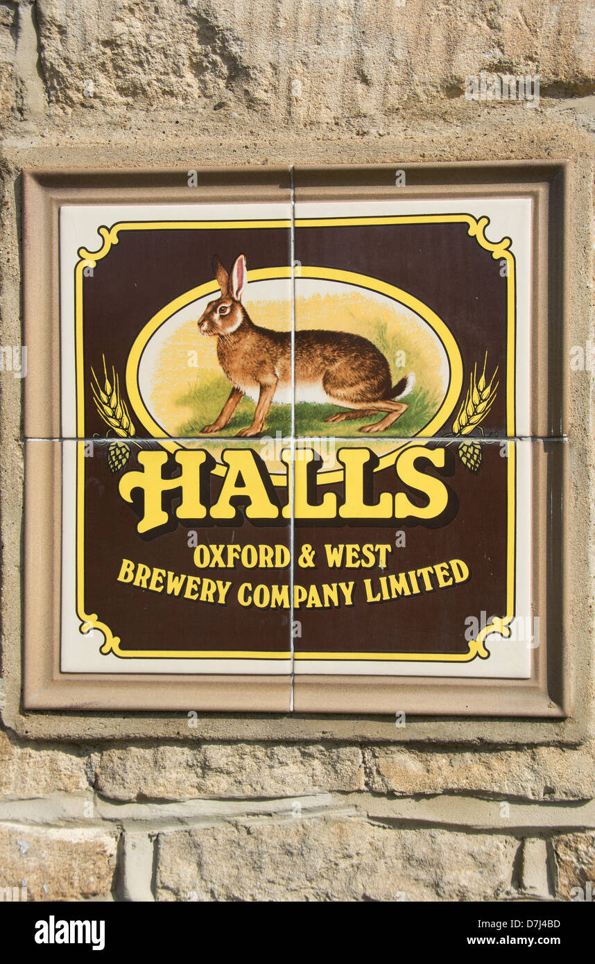 UK. A vintage tiled beer advertisement built into the wall of a pub. - Stock Image