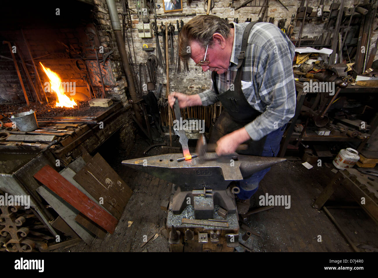 traditional blacksmith at work in Holland - Stock Image