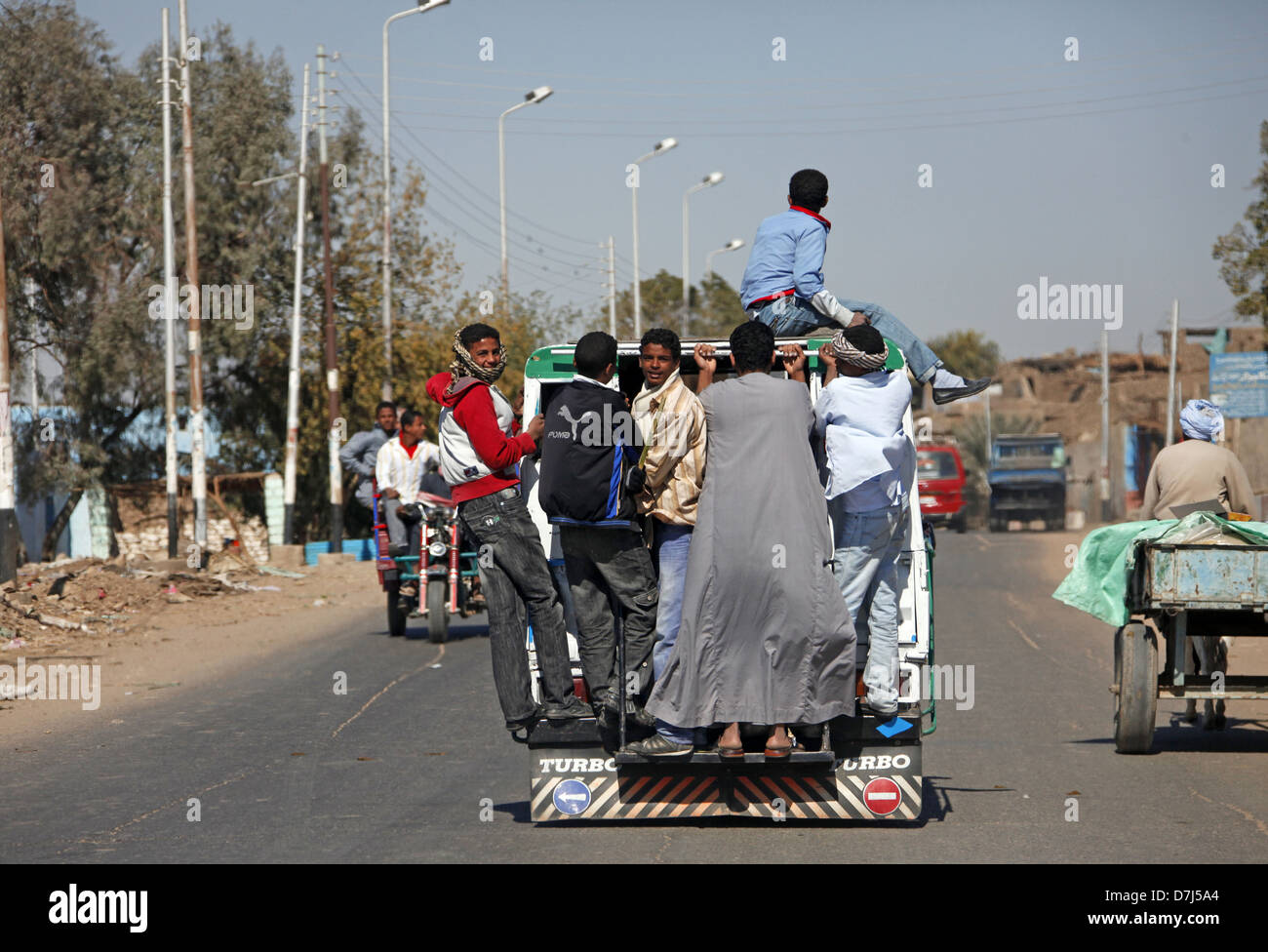 YOUTHS ON PUBLIC TRANSPORT NEAR ASWAN EGYPT 11 January 2013 - Stock Image