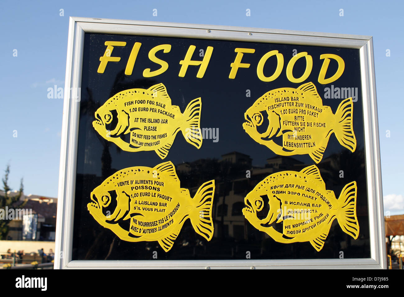 FISH FOOD SIGN IN 4 LANGUAGES HURGHADA EGYPT 06 January 2013 - Stock Image